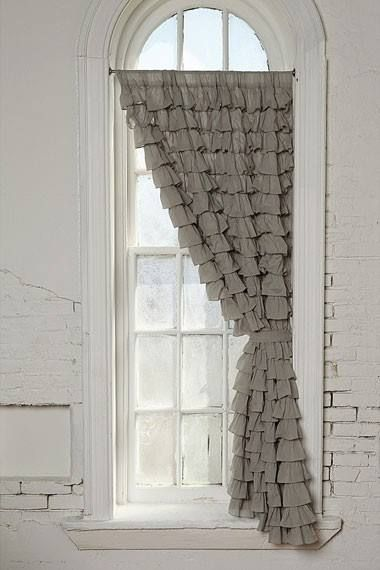 grey window covering over white