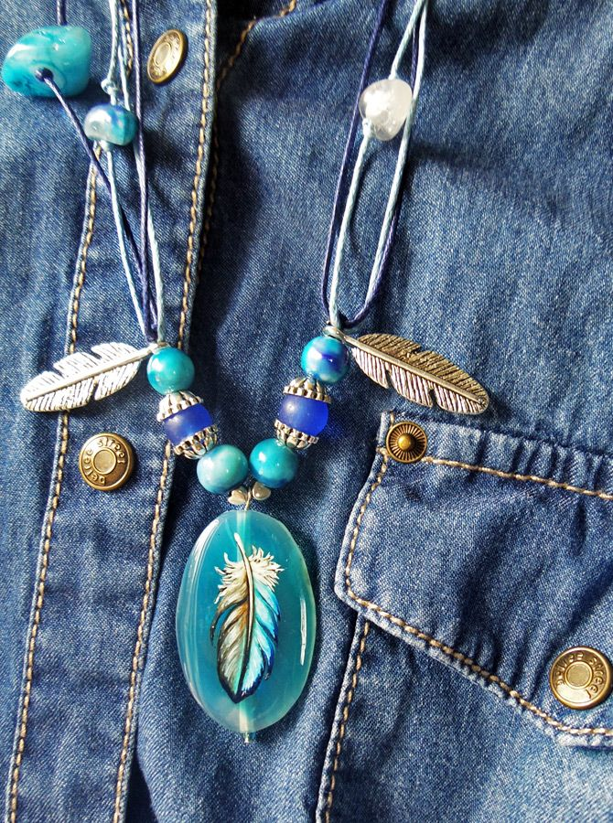The painting on the natural stone Jeans feather