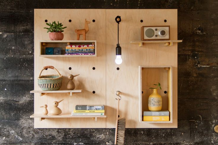 9 Ideas For Using Pegboard And Dowels To Create Open Shelving // This pegboard could be used in place of art, by displaying your favorite pieces.