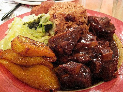 Oxtail with rice and peas with plantain and vegetables on the side.  My mother makes it the best.  Dare to have her cook off against anyone you bring to the table.  All mothers and grandmothers welcome.  Of course, I'll be the judge.