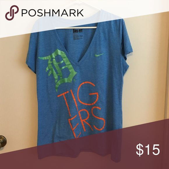 Nike Dri-Fit Detroit Tigers Tee Super fun Detroit Tigers tee by Nike. Soft Dri-Fit material. Heathered light blue with a pearly green and bright orange text. Deep V neck cut. Very minor overall piling but in great shape. Perfect for spring training in FL! Nike Tops Tees - Short Sleeve