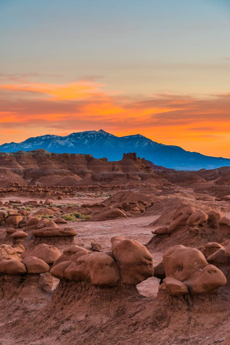 Goblin Valley contrasted by the snowy Henry Mountains. Utah USA [OC][40006000] #reddit