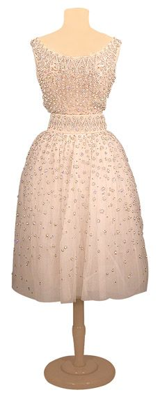 Yves Saint Laurent for Dior Embroidered Tulle Dress  French, 1958  Ivory with small circles of silver thread, sequins and rhinestones, self belt, full skirt, raw edge hem, size 4, labeled: Christian Dior/Printemps-Ete 1958/Paris/93526.