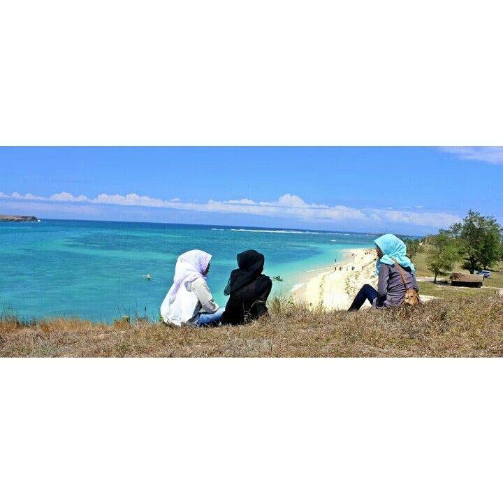 Girls talk in the beach