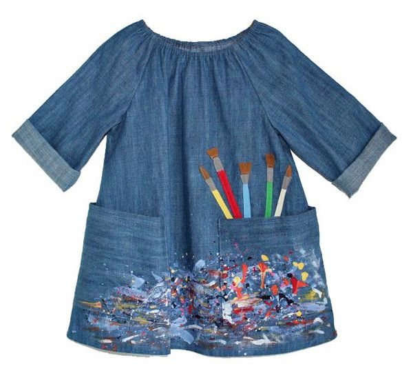 How about an Art Smock from Little Things to Sew in chambray? Cute paint brush appliqué coming out of a pocket.