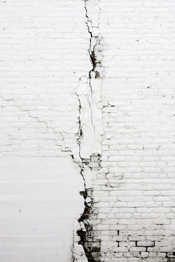 The cracks and the wear and tear are what make it interesting...otherwise it is just a white wall...