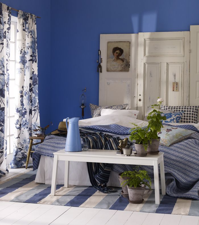 Blue Forever    Roslags Blue on the wall, NCS 1555-R 80 BFlügger.  Linen Curtains Designers Guild.  Doors that headboard.  Bench, Sigurd, Ikea.  Carpet, Rajan, Anna O.