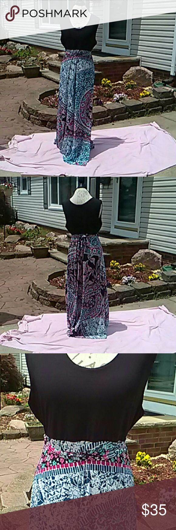 Flirty Pink brand maxi dress💕💕💕💕💕 Beautiful maxi with a black top and Paisley printed skirt that flows flawlessly colors of teal, fuscia,pink,slate blue,royal blue,and purple!! A must have in your closet can be worn for summer weddings,or BBQS,Picnics wherever you go you are sure to turn heads also belts around the waist for a nice cinch! 62 inches from shoulder to hem it's never been worn I'm too short for it😢💞💞💞💞💞💞💞💞💞💞💞💞💞💞🤗🤗🤗🤗🤗🤗🤗🤗 size 2x but can be worn by 3x…