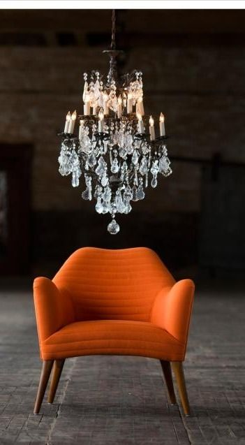 Loving the statement chair with the statement chandelier!