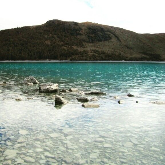 Taking the #bus is possibly the #cheapest way to #travel from #Queenstown to #Christchurch. From #incredible #views over #mountains to short #walk around #nz #turquoise #lakes, that #journey will leave you speechless! Another way to enjoy the simple things