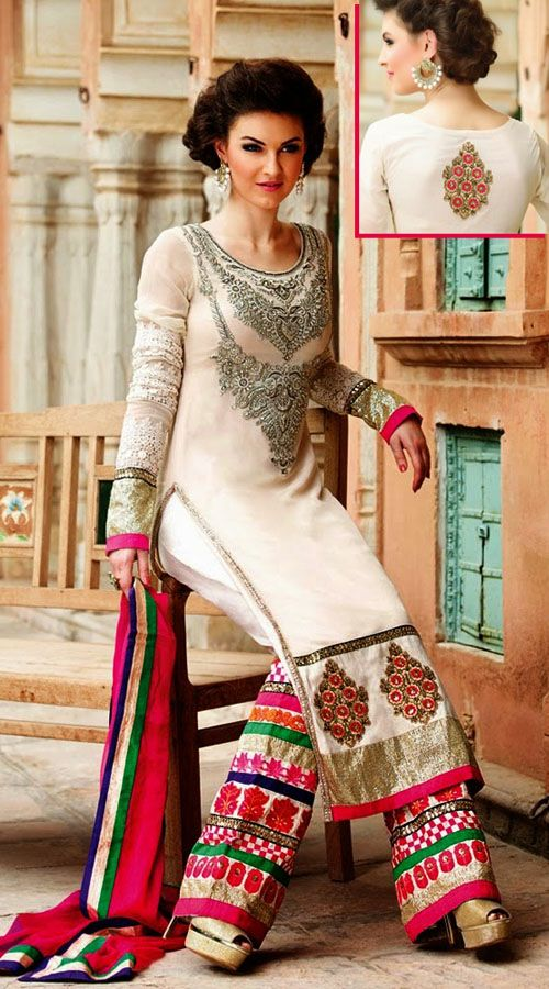 Classy white net palazzo pant suit which is completed with a zari embroidery work on the yoke and vertical panel, golden lace work on the broad border. Matching embroidered bottom and contrast pink dupatta attached with this attire.This Salwar Kameez can be stitched in the maximum bust size of 44 inches.