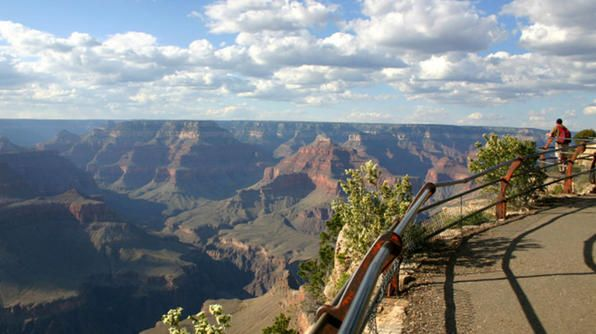 Plan a day of hiking on the Rim Trail, located on the North/South Rim of Grand Canyon National Park. Hikers can start their trek from any viewpoint in Grand Canyon Village or along Hermit Road. The trail stretches 13 miles from South Kaibab Trailhead west to Hermit's Rest. Make sure you pack water before you start this hiking trail. Water is available at the beginning and end of the trail.