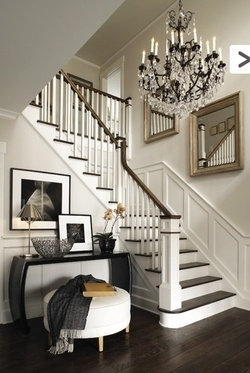 Love the chandelier over the stairs, I love the wainscoting, dark wood, simple!!
