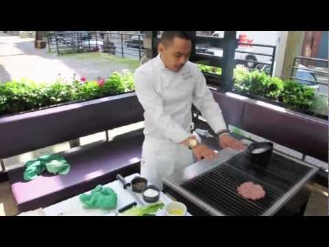 Grilling the perfect burger.