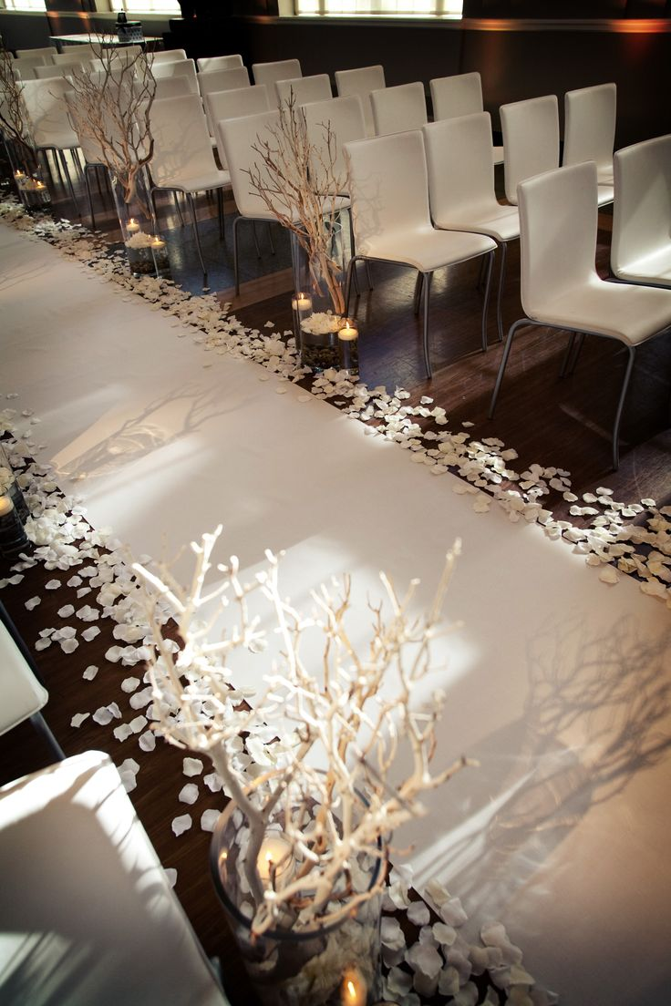 Rose petals and manzanita branches. I think I would cover the chairs with white so you can't see the legs