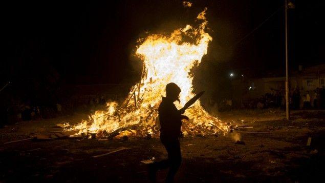 Ultra-Orthodox Jews seen near a big bonfire, during celebrations of the Jewish holiday of Lag B'Omer in the neighborhood of Mea Shearim in Jerusalem on May 25, 2016. (Yonatan Sindel/Flash90)