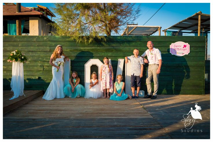 A lovely photo of the newlyweds with their flower girls and pageboy!