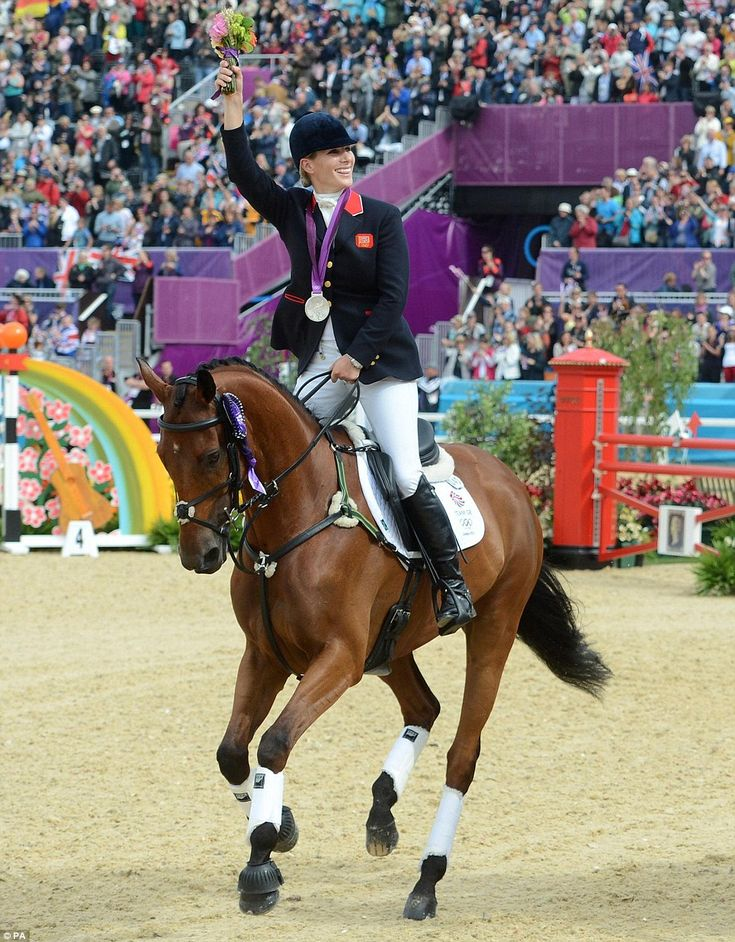 Zara Phillips celebrates with her Silver medal during the Team Eventing Medal ceremony on day four of the London 2012 Olympic Games as the crowds cheer her on.