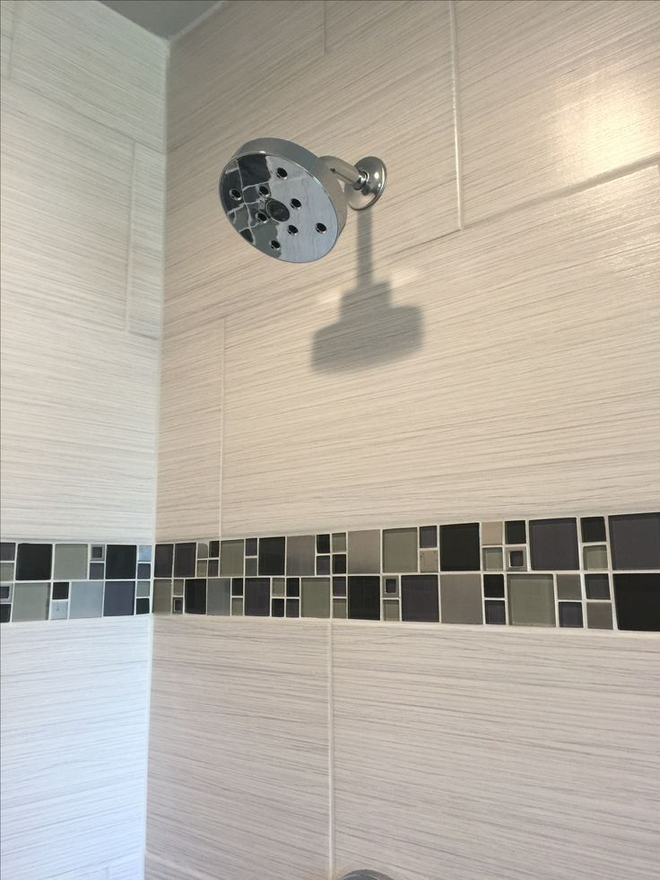 Custom Tiled Shower With 12x24 Satiated Tile Run 13 Staggered Vertically With A Glass And Metal