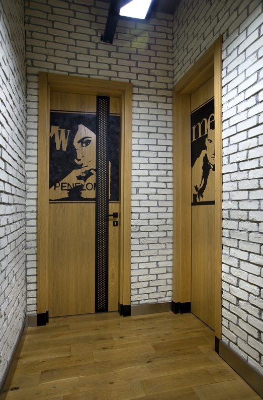 WC Doors painted like magazine covers