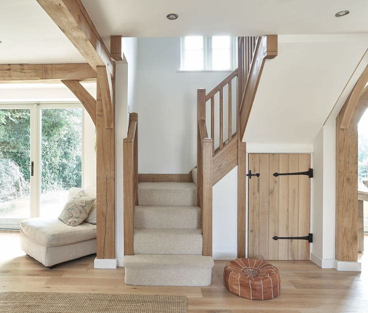Natalie - lovely oak stairs bit with carpet - ideal for us! Also like idea of barn-style doors for under stairs storage (but in white)