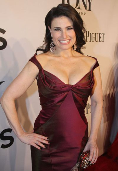 Idina Menzel's mega watt smile, and er noticeable cleavage, were a hit on the Tony Awards red carpet!