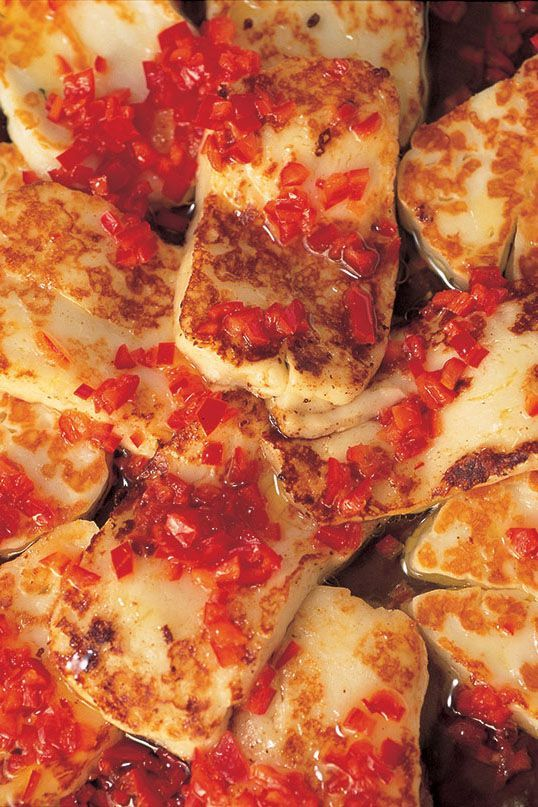 I love the punchy saltiness of halloumi and find it an invaluable standby, since it can be kept in its pack in the fridge for months. This is one of the many ways I cook it, and the confetti of red pepper gives glamour and heat.