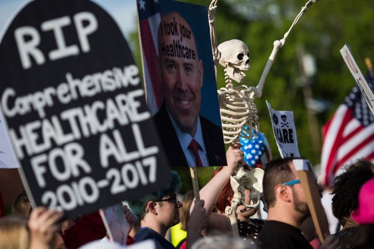 Demonstrators protest before a town hall meeting with US Representative Tom MacArthur (R-NJ) in Willingboro, New Jersey on May 10, 2017. .MacArthur wrote the amendment to the American Health Care Act that revived the failed bill, delivering a legislative victory for US President Donald Trump. / AFP PHOTO / DOMINICK REUTER        (Photo credit should read DOMINICK REUTER/AFP/Getty Images)