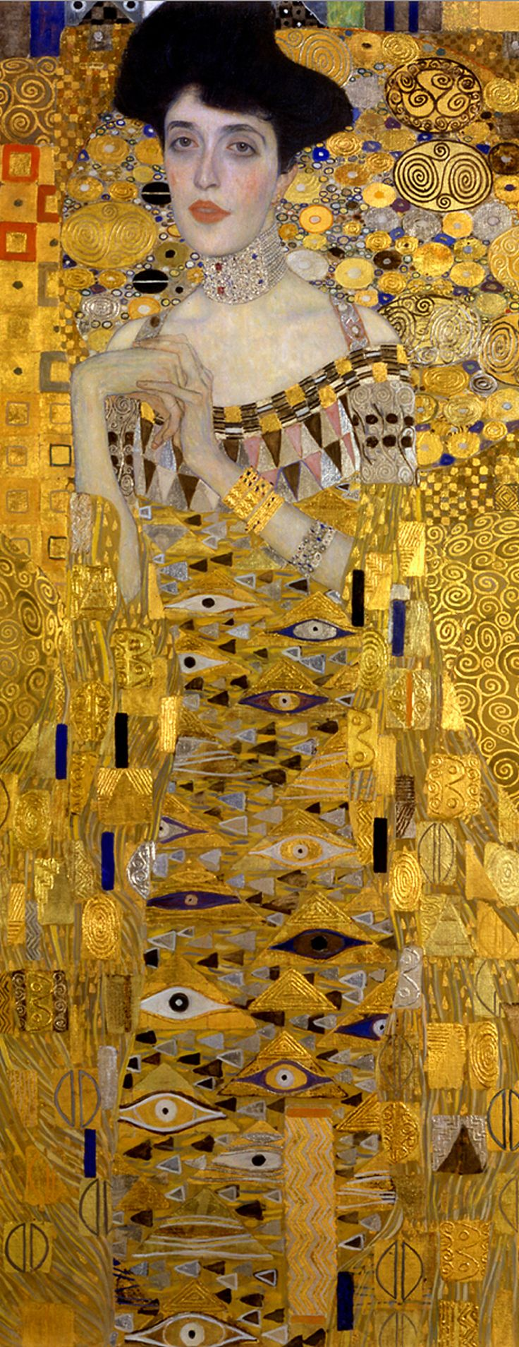 """Adele Bloch-Bauer I"" (1907, Wien). DETAIL: Paintings inside paintings. Studded with precious metals. Opulent patchwork of ornaments, where Mycenaean gold mingles with Byzantium. Creating the overall impression of a religious idol. This is Klimt's expression of the decadent, morbid passion for jewelry. However, the triumph of this goddess is also her prison, captured in her precious tapestries, sealed alive inside a wall of gems."