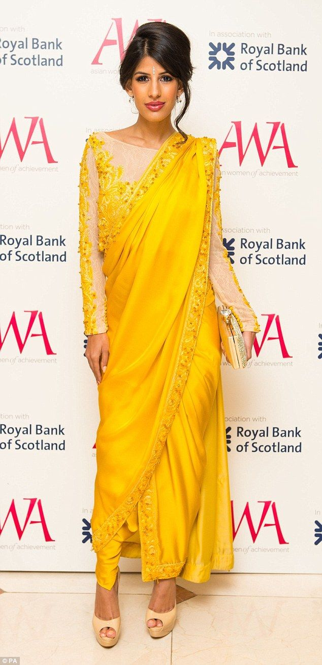 Stunning: Former TOWIE star Jasmin Walia looked beautiful in a yellow sari as she presented a prize at the Asian Women in Achievement Awards in London on Tuesday