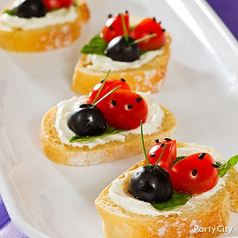 Ladybugs, every little girl's favorite! All you need for this cute party snack is cherry tomatoes, olives, basil leaves, baguette and some extra creamy cream cheese. Yum!