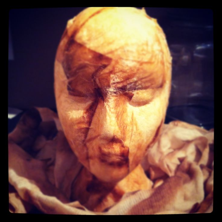 Gauze dipped in steeped tea and draped over a styrofoam head makes a great centre piece!