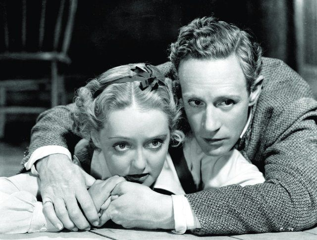 Still of Bette Davis and Leslie Howard in The Petrified Forest...Leslie Howard has a tenderness that makes him so loveable that when I found out he had died in world war 2 I literally cried. watch his movies. you'll cry for him too.