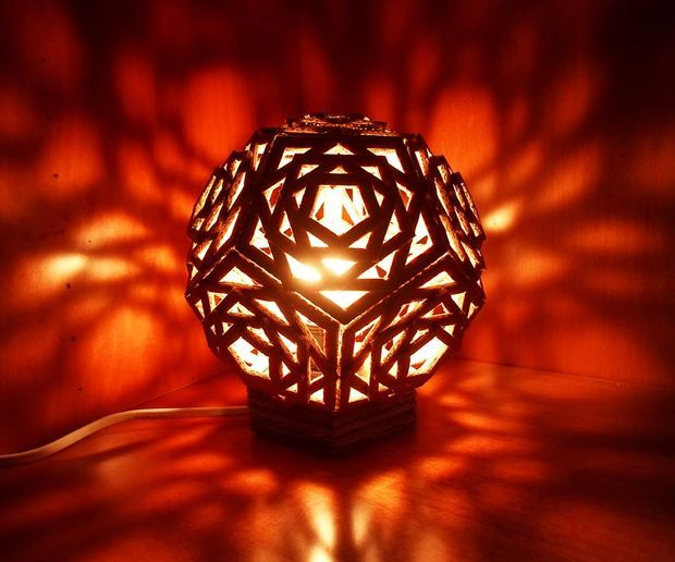 DIY Light Craft: Geometric Cardboard Lamp Light. I can totally make that! Gorgeous all lit up; cool shadows on the wall.