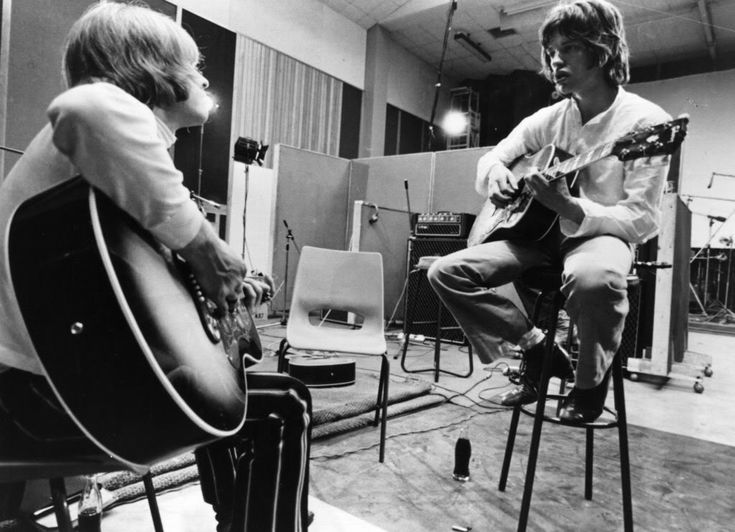 Brian Jones and Mick Jagger  at the Olympic Sound Studios while making Jean Luc Godard's 'Sympathy For The Devil' movie, June 1968...