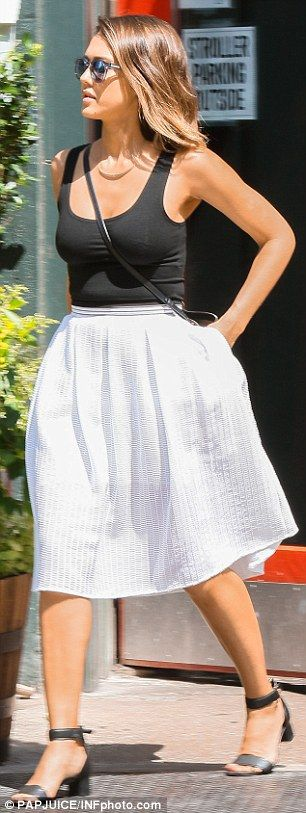 Simple elegance: Jessica kept things basic with a black tank top, a white skirt, and Sunda...