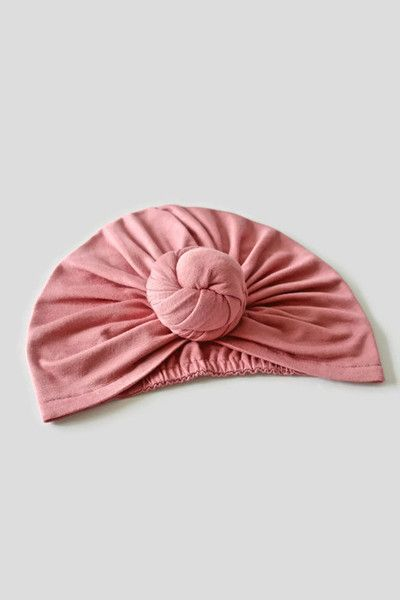 Comfort, luxury and style, bring out your modern bohemian with Mandy Tangerine's exclusive stretch bun turban. Elastic back and buttery soft knit allows for the