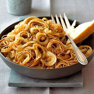 Coiled pasta goes by several names: bird nest pasta, coiled angel hair, and, fideos. This simple pasta recipe with onions goes well with pork or chicken.