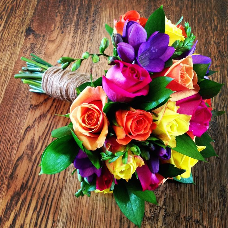 Bright jewell toned wedding bouquet, with roses