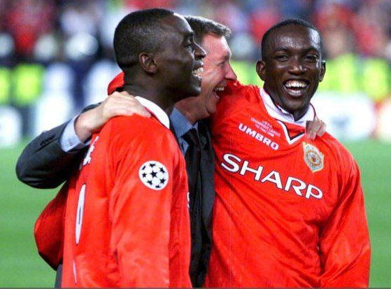 Andy Cole, Sir Alex Ferguson and Dwight Yorke.