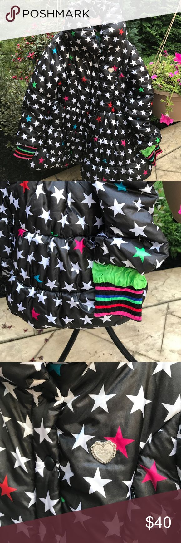 Mimpi Circus Show Girls' Coat Black with White, pink, green, blue stars throughout. Cuffed wrists in stripes of pink, black, red, green and blue. Puffy coat with green lining. Zipper front with 4 snaps from waist up for added warmth. Mim-Pi Jackets & Coats Puffers