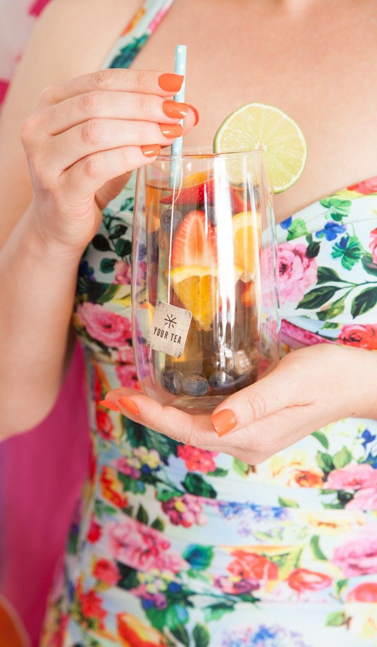 So Yummy! Fruit infused ice tea perfect for summer with Your Tea Tiny Tea, orange slices, strawberries, blueberries, and garnished with lime.