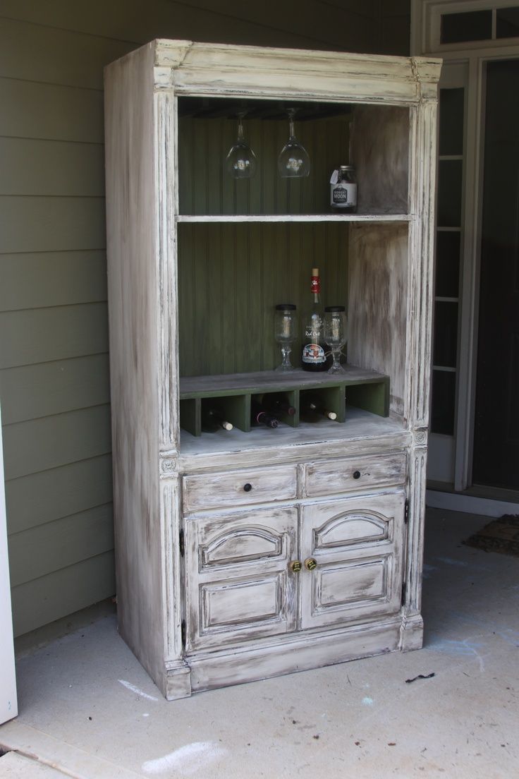 This stunning shabby chic wine rack is gorgeous! This piece is painted off white, distressed and glazed with a dark glaze to give it the vintage shabby chic look. All pulls are brand new and the pulls on the bottom look like wine corks! Good idea for an old entertainment cabinet!!!