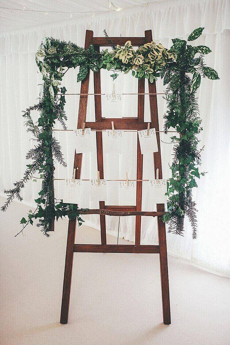seating chart on a wooden easel.