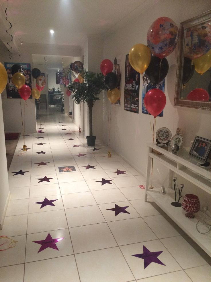Hollywood themed 18th birthday party! Hollywood walk of fame stars on the floor with guests names written on the stars. Movie posters and balloons great for photos