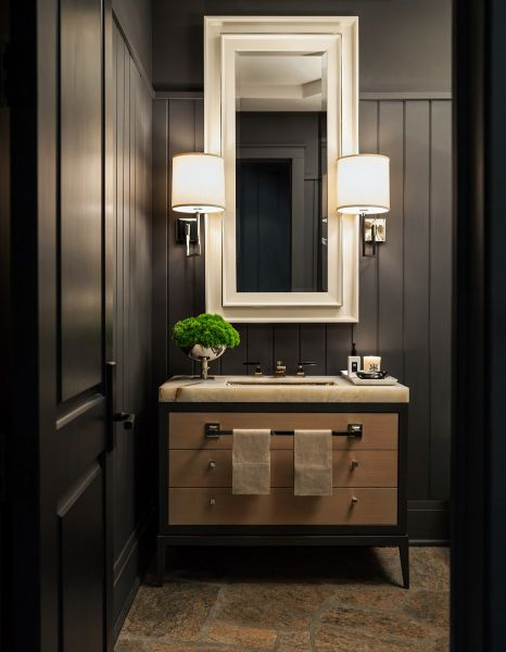 rich black walls thick marble surface sleek maple vanity drum shaded sconces and tall double framed mirror by powell bonnell xo elle