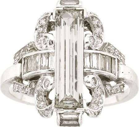 Art Deco Diamond & Platinum Ring  The ring features a baguette-cut diamond measuring 13.65 x 3.85 x 2.70 mm & weighing approx 1.20 cts, enhanced by baguette & single-cut diamonds, set in platinum.