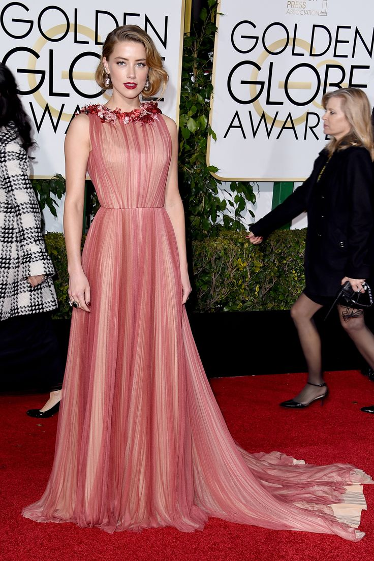 Amber Heard is flawless in chiffon Gucci with flower embellishment at the neckline.