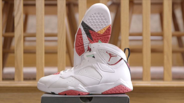Reviewer Brad Hall Unboxes Air Jordan VII Retro Hare Sneakers While Wearing a Baby