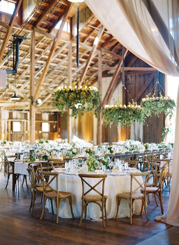 Gorgeous reception with hanging candles and greenery decor!